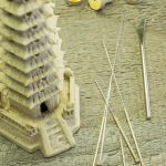 small model of pagoda tower with acunpunture tools nearby